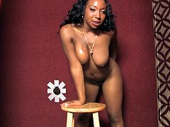Prepare your cock for this ebony babe, with big jugs wearing high heels, while she sucks a big schlong and masturbates at the same time.