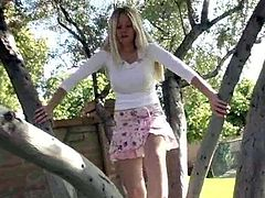 Drop dead gorgeous Alison Angel pulls up her top and breaks out her amazing melons when she climbs a tree and gets naked in public.