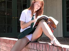 Lacie is the slim redhead babe in a school uniform. She reads some book. Her skirt is so short that you can see her white panties. This babe gets horny so, she lifts the skirt up to show her teen pussy.