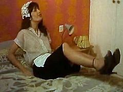 Brunette MILF is getting screwed bad in the bedroom. She moans seductively so the sound she produces attracts two luscious maids. They spy on the couple through the tiny hole in the opened door. Exciting retro sex video presented by The Classic Porn.