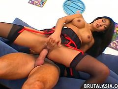 Amazing Asian bondage babe Lucy Lee is dressed in sexy lingerie and is taking on a guys hard cock. After sucking him he cums over a glass table which he makes Lucy lick up.