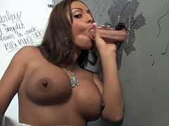 That's why she enters this gloryhole room and starts polishing that thick white cock! The way she sucks gives the guy behind the wall some feelings.