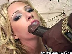 Entertain yourself by watching this blonde cougar, with big fake tits wearing sexy clothes, while she goes hardcore with two black guys.