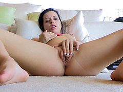 Sexy brunette chick masturbates lying on the floor. This horny girl rubs her pussy lips and nipples. Nothing can be better than a masturbation on a nice summer day.