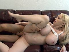 Get a load of this hardcore scene where the busty blonde milf Candy Manson shows off her massive breasts before being fucked by big cock.