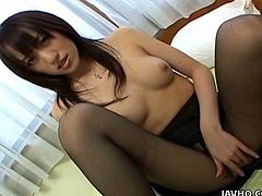 A beautiful Japanese girl fondles her nice titties and pussy. Later on she starts to toy her vagina with different sex toys.
