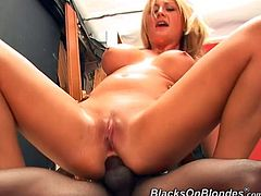 Get wild watching this blonde babe, with big jugs and a shaved cunt, while she goes really hardcore with two black fellows and moans loudly.