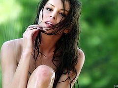 Touch yourself watching this brunette, with big natural jugs and a shaved pussy, while she wets herself outdoors in a reality video.