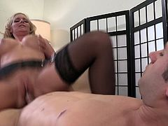 Curly haired MILF with thick booty wearing black stockings gets her cunt plowed by cocky stud doggystyle and rides his big cock shaking her massive tits up and down.