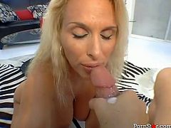 This chick is a gifted cock sucker. From the way she is sucking on her lover's throbbing cock you can tell that she is really into him.