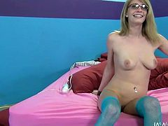 Bitchy blonde chick in blue stockings Allie lies on bed while one dude smears her body with oil. Nasty girl smokes cigarette and blows plastic dildo.