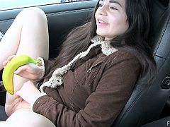 Hot brunette girl flashes her tits in a grocery store. She buys the banana and goes at the parking. She gets into a car and starts to drill her hot pussy with the banana.