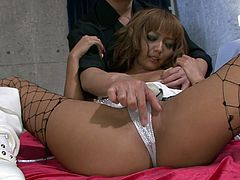 Dirty Japanese wench Kyoko looks sassy wearing fishnet stockings and white satin lingerie. She gets her shaved snatch finger fucked. Then the guy licks her pussy intensively bringing her sexual delight.