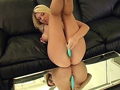 Get a hard dick watching this blonde doll, with natural love pillows wearing high heels, while she touches herself and toys her pussy.