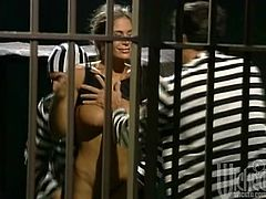 Sexy girl in a prion guard uniform gives a blowjob to one of the inmates through prison bars. She gets so damn horny that opens the cell and let the guys fuck her.