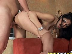 Get wild watching this brunette cougar, with natural breasts and a sweet pussy, while she gets fucked doggystyle in a reality video.