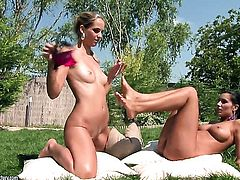 Blonde Melissa Ria finds herself getting her beaver rubbed by lesbian Anita