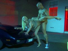 Gorgeous blonde chick in a dress and high heels lies down on a car hood. Stormy gives head to a brutal guy and then gets fucked hard. She also gets her boobs cum covered.