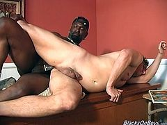 Craig Summers and his lewd buddies are having group gay interracial sex in an office. The white dude pleases the black men with blowjobs and then gets his ass drilled on the desk.