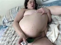 Witness this clip where a brunette BBW, with immense gazongas and smooth twat, plays with a dildo and gets fucked hard by a lusty dude.