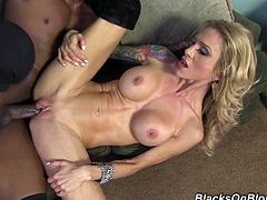 Get excited watching this tattooed blonde, with giant knockers wearing a sexy bra, while she goes really hardcore in the missionary position.