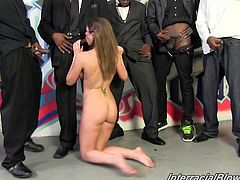 Lovely White sucks huge black dicks standing on her knees. Of course she also takes a pussy pounding in this wild interracial gangbanged video.