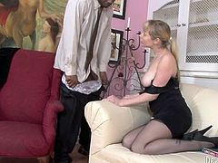 Appetizing well shaped white chick in sexy black lingerie and stockings fucks her man's black cock and lets him bang her missionary style.