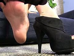 Kaylee Hilton in Black Meat White Feet, doing a wonderful foot-job.See how this sexy busty blonde milf grabs that big hard black cock by her feet and jerks it nicely by showing her ass, till she gets her feet covered in cumshot.