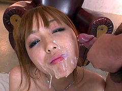 Tight and hot Asian lady Anri Hoshizaki sits in bed giving blowjobs to two studs. Later one Anri closes her eyes and takes two loads of hot jizz on her beautiful face.