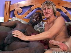 Make sure you see this! A blonde boy, with a big cock and a cute smile, gets fucked hard by a hot black fellow over a big nice bed.