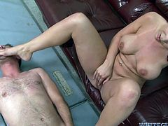 Beverly Hills is a hot brunette with an amazing ass and massive round tits. Watch this babe giving this guy a footjob before sucking on his cock.