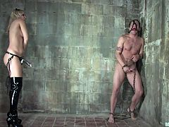 He is cowering in the corner, but he can't hide. She pushes him against the wall and fucks his tight little butthole with her massive strap on. The torture is not done yet as she puts clothespins all over his body including on his cock.
