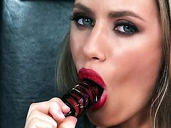 Nicole Aniston with big tits and clean bush gives a closeup of her snatch as she masturbates