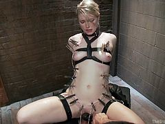 Slim, tall and beautiful, blonde Ella finally found her perfect place to be! We brought her inside our vault where she received a rough fuck and punishment, just they way she likes it. With laundry pliers all over her body, a vibrator on the clit and a big dick in her pussy, Ella moans with pleasure and satisfaction