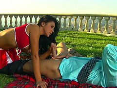 Busty brunette cheerleader Audrey Bitoni is playing dirty games with her BF outdoors. She pleases the dude with a blowjob and then lets him pound her cunt doggy style.