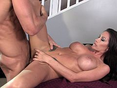 Make sure you see this! Watch this brunette MILF, with giant knockers wearing red high heels, while she gets fucked hard over a table.