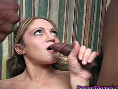 A pleasurable girl sucks two big black cocks lying on a bed. These dudes puts condoms on their big dicks and start to fuck the girl.