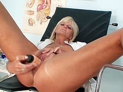 Stretching her wet cunt makes mature nurse to moan of pleasure