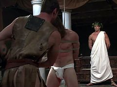 In ancient Rome Caesar ruled everything, including his war capture. Talking about capture, just look what he has after he's last conquest. A beautiful male, brought in as a prisoner to please Caesar. He wants him nice and obedient so his men are now taking care of this hunk by destroying his self esteem.