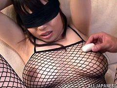 Blindfolded and wearing a sexy fishnet costume, babe Rion is looking smoking hot! Her nipples are hard and her pussy is getting soaking wet! This guy gapes her unshaved snatch, rubs it slowly, and then uses a small vibrator to tease her. Is miss Rion ready for cock now or does she needs a rough fingering?
