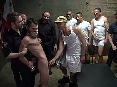 Life in prison can be hard, but not as hard as this guy's is! He heard about prison gang bangs but never thought that the guardians are involved in! One day, he was taken out from his cell by the guardians and then knelt. The guards kept him on his knees as the inmates took turns in mouth fucking him.