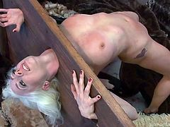 She's slim, hot and obeys her man's will. Lee's guy has his kink and he immobilized this sexy white haired chick in a simple, yet very efficient bondage device. She stays in it as he feeds her with cock, whips her boobs and then fucks her tight, bald pussy. Damn, this is hot but just wait to see the rest of it!
