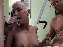 A dirty fuckin' bitch with a buzz cut sucks on two hard cocks and gets fuckin' fucked in this hot threesome scene. Check it out!