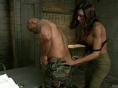 This guy is being interrogated but he's not giving up the answers that the transsexual mistress needs. She bends him over the desk and fucks him hard in the asshole in the hopes her will spill his beans to her.