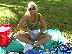 Prepare your cock for this blonde babe, with huge love pillows wearing shorts, while she plays with her pink teddy bear outdoors.