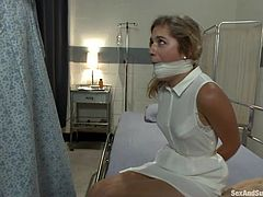 Pete ties up nurse Lia Lor and throws her onto the bed. He takes the ball gag out of her pretty mouth and sticks his hard dick down her throat. He pushes her head down onto her hard cock so she sucks him harder and deeper.
