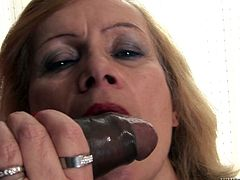 Have fun with this hardcore interracial scene where a horny mature blonde is fucked by a big black cock that leaves her covered by cum.