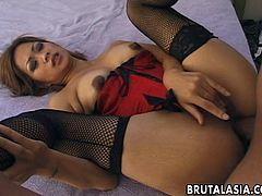 Take a look at this naught Asian slut in her lingerie and fishnet stockings. She lays back on the bed, spreads her legs and gets ready for a big black cock to be shoved into her tight asshole. She rides the cock like she is a professional.