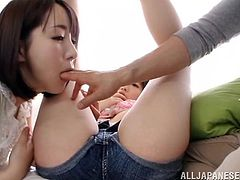Hitomi Fujiwara watches as her best friend gets her nipples licked by her boyfriend in this sexy threesome scene. She licks her friend's ass with her boyfriend and he fingers her bald pussy from behind.