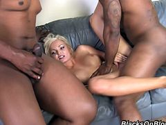 Masturbate watching this long haired blonde, with big knockers and a cute butt, while she goes hardcore with two black guys in the missionary position.